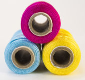 Rolls of thread with CMYK colors. Royalty Free Stock Photo