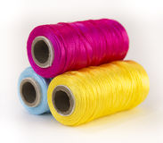 Rolls of thread with CMYK colors. Royalty Free Stock Image