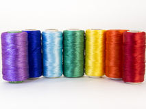 Rolls of thread with rainbow colors. Stock Image