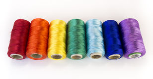 Rolls of thread with rainbow colors. Stock Photo