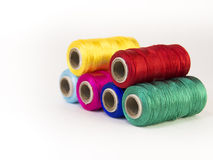 Rolls of thread with RGB and CMYK colors. Stock Photo