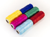 Rolls of thread with RGB and CMYK colors. Stock Image
