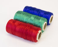 Rolls of thread with RGB colors. Stock Photos