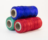 Rolls of thread with RGB colors. Stock Photo