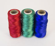 Rolls of thread with RGB colors. Stock Image