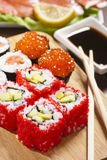 Rolls with tobiko, avocado and cucumber. Still-life stock photo