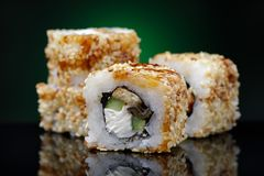 Rolls of Unagi maki with cucumber, eel, sesame and red fish Stock Images