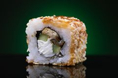 Rolls of Unagi maki with cucumber, eel, sesame and red fish Royalty Free Stock Images