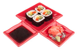 Rolls with vegetables on plate, soy sause, ginger, wasabi Stock Photography
