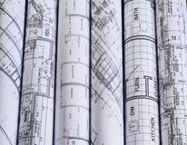 Rolls von Architekturplan- u. -hausplänen Hintergrund lizenzfreie stockbilder