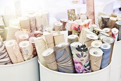 Rolls of wallpaper. In barrels royalty free stock image