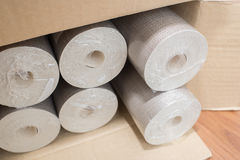 Rolls of wallpaper in the box Stock Photo