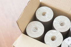 Rolls of wallpaper in the box Stock Photos