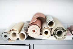 Rolls Of Wallpaper. On desk Stock Images