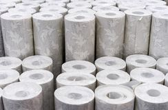Rolls of wallpaper with a picture on the counter of the store royalty free stock photos