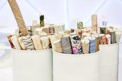 Rolls of wallpaper. In barrels stock photos