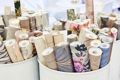 Rolls of wallpaper. In barrels stock photography