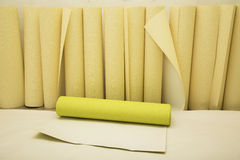 Rolls of wallpaper of two colors ready for applying Royalty Free Stock Image