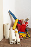 Rolls of wallpapers and various tools for wallpapering. Stock Photography