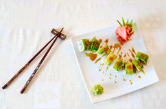 Rolls, wasabi and ginger. On a white plate and a light background Stock Photos