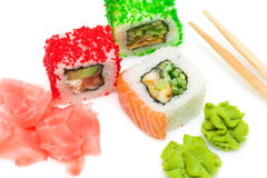 Rolls, wasabi, pickled ginger and chopsticks on white background Stock Photography