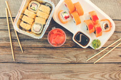 Rolls, wasabi, soy sauce, ginger on the table. Stock Photos