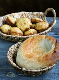 Rolls in a wattled basket on an old table Royalty Free Stock Image