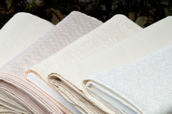 Rolls of white fabric. For wedding dresses Stock Images