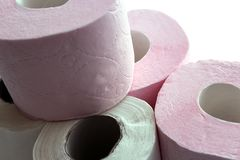 Rolls of white and pink toilet paper stacked with a slide Stock Photography