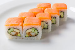 Rolls on the white plate. Japanese cuisine. Seafood stock photography
