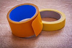 Rolls of wide and narrow duct tapes on vintage Royalty Free Stock Images