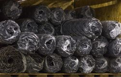 Rolls of wire mesh steel for construction lie on the shelf of the warehouse Stock Photo