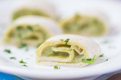 Rolls wrapped bread, tortilla, pita stuffed with avocado cream Stock Images