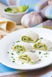 Rolls wrapped bread, tortilla, pita stuffed with avocado cream Stock Photo