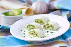 Rolls wrapped bread, tortilla, pita stuffed with avocado cream Stock Image