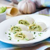 Rolls wrapped bread, tortilla, pita stuffed with avocado cream Stock Photos