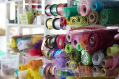 Rolls of wrapping paper on the shelves stock photo