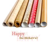 Rolls wrapping paper with streamer for gifts Stock Photos