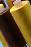 Rolls of yellow and brown cotton. Macro view of rolls of yellow and brown cotton stock photography