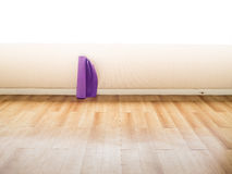 Rolls of yoga mats left in the room. Rolls of yoga mats left in the yoga gym room Royalty Free Stock Photo