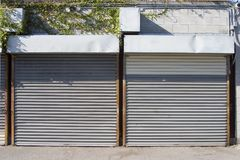 Rollup Doors 1. Metal rollup doors protect two storage spaces stock photos