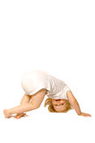 Rolly polly toddler. Toddler girl having fun, about to do a tumble over, on white background stock photography