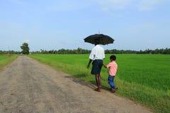 Rolnik chodzi z chłopiec l Obraz Royalty Free