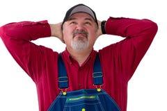 Rolnik lub pracownik w kombinezonu przyglądający up zdjęcia royalty free
