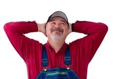 Rolnik lub pracownik z dużym szczęśliwym uśmiechem obrazy royalty free
