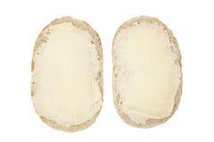 Rolo de pão com manteiga Fotos de Stock