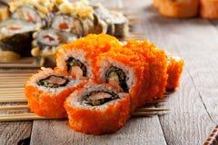 Rolo de sushi em varas Fotografia de Stock Royalty Free