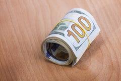 Rolo do dinheiro com dólares americanos Imagem de Stock Royalty Free