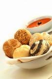 Rolos de pão com sopa do tomate Imagem de Stock Royalty Free