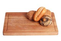 Rolos de pão do gourmet a bordo Fotos de Stock Royalty Free